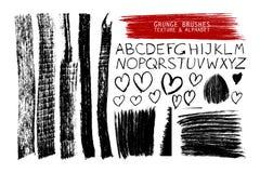 Set of grunge brushes and alphabet Stock Photography