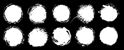 Set of grunge circles. Vector grunge round shapes.  Black and white alpha channel shapes, stains and dirty splashes and spots. Stock Photos