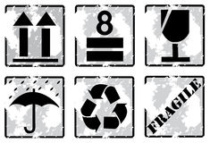 Set of grunge fragile symbol. On cardboard isolated on white - vector Royalty Free Stock Images