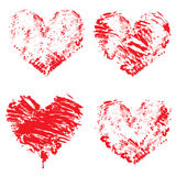 Set of grunge red color figures - hearts. Isolated on white back Stock Photo
