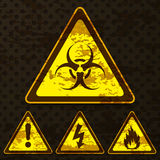 Set of grunge warning signs. Isolated on dark dotted background. Vector illustration Royalty Free Stock Photography