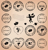 Set - grungy post stamps with angels and hearts Stock Photos