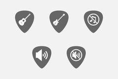 Set of guitar plectrums with  sound and music related icons Stock Images