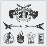 Set of guitar shop labels, emblems, badges and music icons. Black and white royalty free illustration