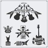 Set of guitar shop labels, emblems, badges and music icons. Royalty Free Stock Image