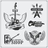 Set of guitar shop labels, emblems, badges and music icons. Royalty Free Stock Images