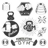Set of gym labels in retro style. Sport fitness emblems, badges and logos for design. Vector illustration Stock Image