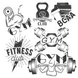 Set of gym labels in retro style. Sport and fitness emblems. Vector illustration. Stock Photos