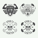 Set of gym logos, labels and badges in vintage style Stock Photos