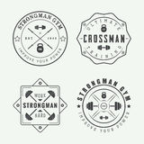 Set of gym logos, labels and slogans in vintage style Stock Image