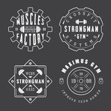 Set of gym logos, labels and slogans in vintage style Stock Photos