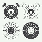 Set of gym logos, labels and slogans in vintage style Royalty Free Stock Image