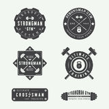 Set of gym logos, labels and slogans in vintage style Stock Images