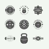 Set of gym logos, labels and slogans in vintage style. Stock Images