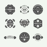 Set of gym logos, labels and slogans in vintage style. Royalty Free Stock Image