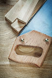 Set of hacksaw timber on wood board construction concept Stock Photo