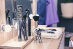Set of hairdresser tools on table. In salon Royalty Free Stock Photos