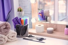 Set of hairdresser tools on table. In salon Stock Image
