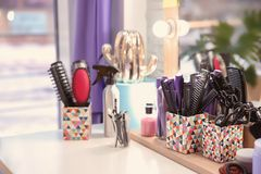 Set of hairdresser tools on table. In salon Stock Photography