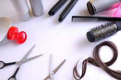 Set hairdressing articles around a white table top view Stock Photos
