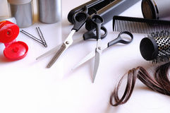 Set hairdressing articles on a white table composition Stock Image