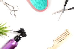 Set of hairdressing tools on white background with copy space, combs, scissors, spray and bleach brush on white background, top. View and flat lay stock photography
