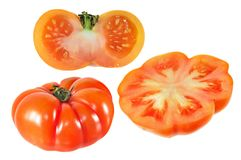 Set of half cut and whole Italian flat red tomato isolated on white background stock images