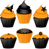 Set of halloween cupcakes. Halloween cupcakes in orange and black with cobweb, spider, star and bats Royalty Free Stock Images