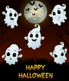 Set of halloween emotional ghosts on grass background Royalty Free Stock Photo