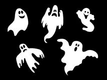 Set of halloween ghosts. Illustration of set of white halloween ghosts, isolated on black background Royalty Free Stock Photos