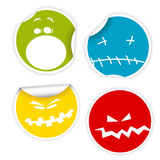 Set of Halloween smiles labels. Set of colorful Halloween labels with various smiles Royalty Free Stock Images