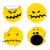 Set of Halloween yellow smiles labels Stock Photo