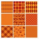 Set Halloweenowej szkockiej kraty bezszwowi wzory w pomarańcze Zdjęcia Royalty Free