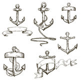 Set of hand drawn anchors and ribbons Royalty Free Stock Photos