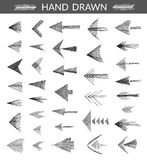Set of hand drawn arrows, made with strokes by ink pen Royalty Free Stock Photo