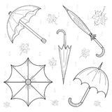 Set of Hand Drawn autumn umbrellas, leaves and drops. Royalty Free Stock Photography