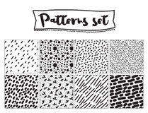 Set of hand drawn backgrounds. Black and white colors. Seamless patterns. Stock Images