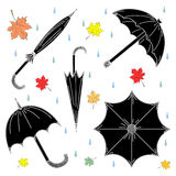 Set of Hand Drawn Black Umbrellas, Colorful Autumn Leaves and Drops.  Perfect for Print Royalty Free Stock Image