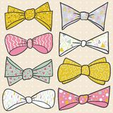 Set of hand drawn bow with cute ornaments. Stock Photo