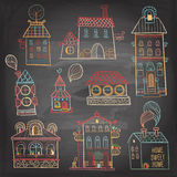 Set of hand drawn buildings in vintage style on dark background. Royalty Free Stock Photos