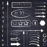 Set of hand drawn chalk arrows and symbols. Royalty Free Stock Photos