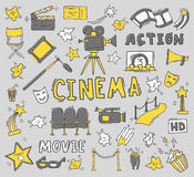 Set of hand drawn cinema icons. Cinema hand drawn colorful icons . Set with clapperboard, camera, chairs, award, film strip, popcorn ticket and others. Vector Stock Photos