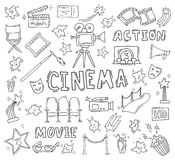 Set of hand drawn cinema icons. Cinema hand drawn decorative icons isolated. Set with clapperboard, camera, chairs, award, film strip, popcorn ticket and others Royalty Free Stock Photos