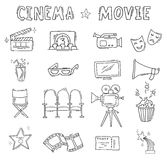 Set of hand drawn cinema icons. Cinema hand drawn decorative icons isolated. Set with clapperboard, camera, chairs, award, film strip, popcorn ticket and others Royalty Free Stock Image