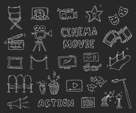Set of hand drawn cinema icons. Cinema hand drawn decorative icons isolated. Set with clapperboard, camera, chairs, award, film strip, popcorn ticket and others Royalty Free Stock Photography