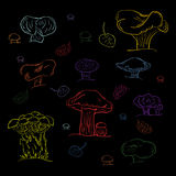 Set of Hand Drawn Colorful Mushrooms Isolated on Black. Doodle Style. Autumn Falling Leaves. Royalty Free Stock Photography