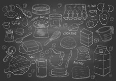 Set of hand drawn elements for cooking pastry on chalkboard stock photography