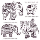 Set of hand drawn ethnic elephants Stock Photos