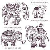 Set of hand drawn ethnic elephants Stock Photos