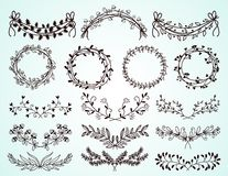 Set of hand-drawn floral borders and wreaths Royalty Free Stock Photo